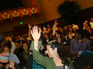 Audience raising hands to indicate where they're from