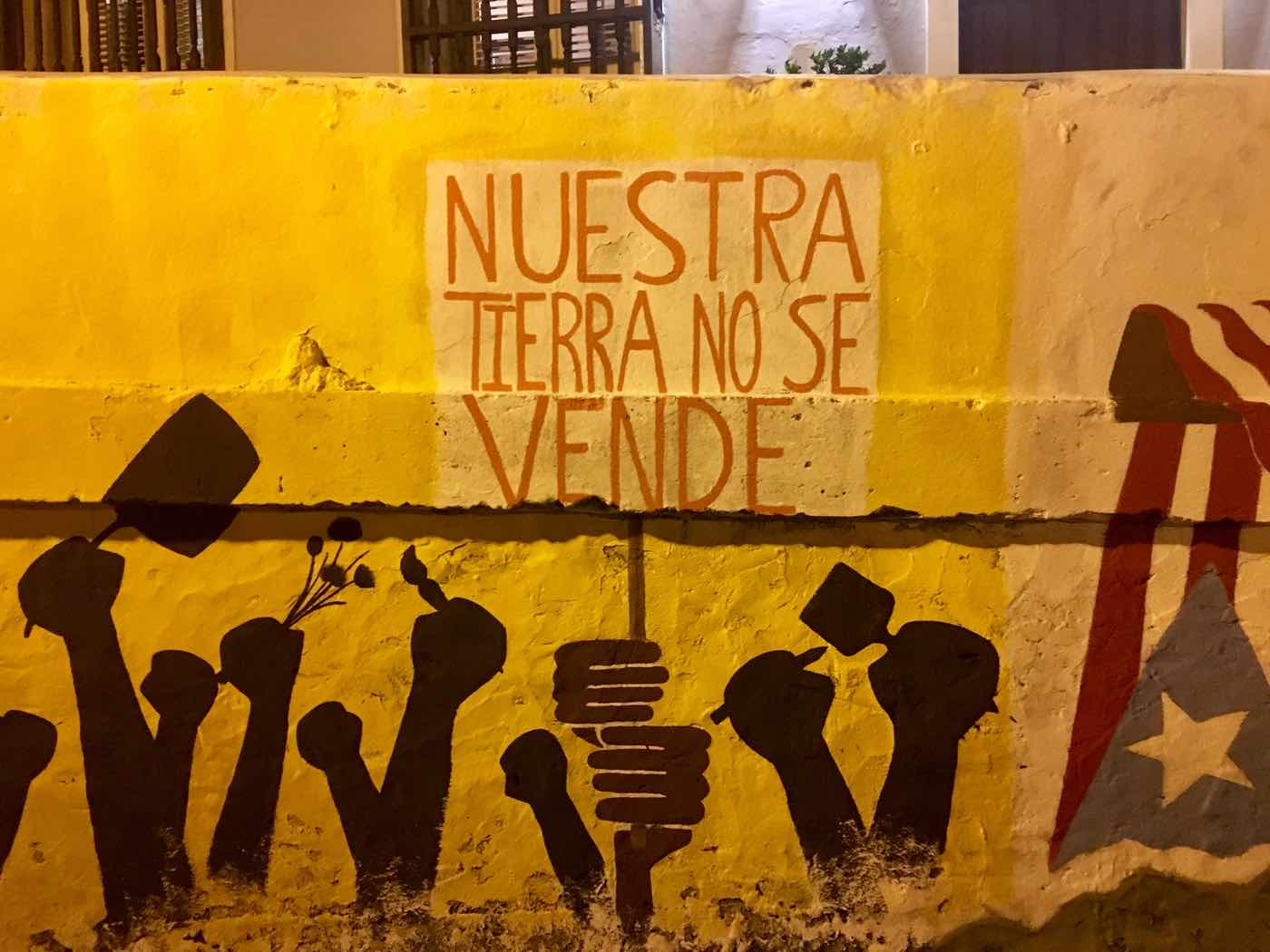 "A mural in Puerto Rico reading ""Our land is not for sale."""
