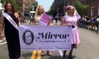 Mirror Trans Beauty Co-op members marching in a 2019 Pride parade.
